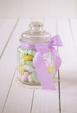 Candy jar filled with sugar covered almonds Stock Image