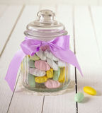 Candy jar filled with sugar covered almonds Royalty Free Stock Photos