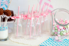 Candy jar and milk bottles Royalty Free Stock Images