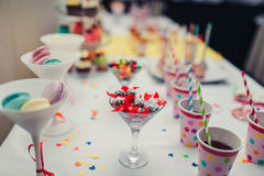 Candy jar at wedding celebration. Candy jar and drinks on a dessert table at party or wedding celebration royalty free stock photo