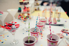 Candy jar at wedding celebration. Candy jar and drinks on a dessert table at party or wedding celebration stock photo