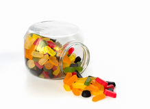 Candy jar with wine gums. Candy jar on its side filled with wine gums royalty free stock image