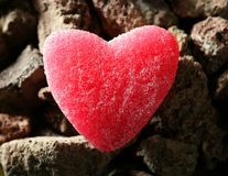 Candy jelly read heart over stones Royalty Free Stock Photos