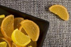 Candy jujube as lemon and orange slices Stock Photo