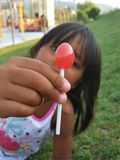 Candy. A Kindless girl with a lolipop Stock Photography