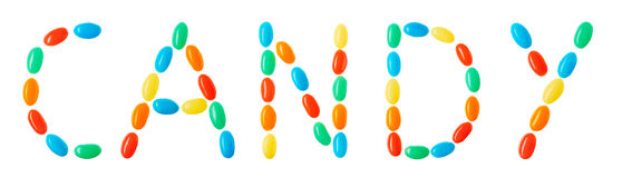 Candy lettering made of multicolored candies isolated on white Royalty Free Stock Photography
