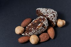The candy lies near nuts royalty free stock photography