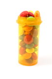 Candy like it's medication. Candy placed in a medication pill bottle displayd on a white ackground Stock Images