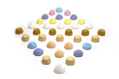 Candy little cupcacakes. Candies little cupcakes of different colors lying in the form of a rhombus Royalty Free Stock Photography