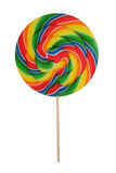 Candy Lollipop. A colorful rainbow flavored lollipop isolated over white royalty free stock images
