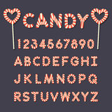 Candy lollipop alphabet letters and numbers. Alphabet letters and numbers in red and white swirl  candy lollipop style Stock Images