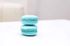 Candy macaroons peppermint  colors  on the white  table Stock Images