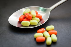 Candy in metal spoon. Stock Photography