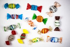 Candy ornaments on white background made of glass. Colorful candy ornaments on white background made of glass stock images