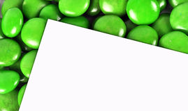 Candy with paper. Close-up of green candy with paper Royalty Free Stock Photography