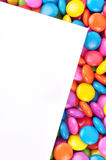 Candy with paper. Close-up of Colorful candy with paper Royalty Free Stock Photography
