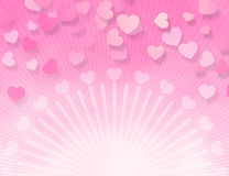Candy Pink Hearts. Pink hearts floating over bright sunburst Stock Photo