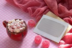 Candy pink jelly sprinkled with sugar coffee cup and marshmallow Valentine card background. Candy pink jelly sprinkled with sugar coffee cup and marshmallow royalty free stock images
