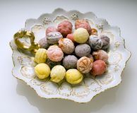 Candy on plate. Hard colored candies on ceramic plate Royalty Free Stock Images