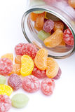 Candy pouring from jar Royalty Free Stock Image