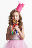 Candy princess girl. Beautiful little candy princess girl in crown holding big lollipop isolated on white Royalty Free Stock Image