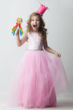 Candy princess girl. Beautiful little candy princess girl in crown holding big lollipop and smiling Royalty Free Stock Photography