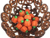 Candy pumpkins in nut shell bowl Stock Photo