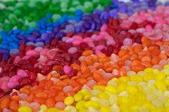 Candy rainbow. Background - 100s of candies Royalty Free Stock Photo