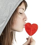 Candy red heart in the girl's lips Stock Photos