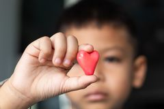 Candy red heart in hand a boy. stock photo
