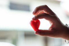 Candy red heart in hand a boy. Candy red heart in hand a boy , Thailand royalty free stock image