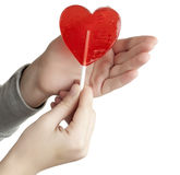 Candy red heart in the hands Royalty Free Stock Photography