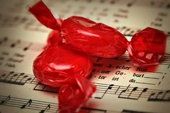 Candy. Red candy on a musical background Stock Image