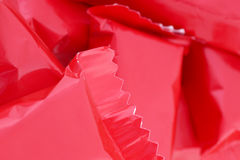 Candy in a red wrapper. Stock Image