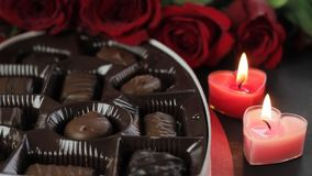 Chocolate, roses and heart-shaped candles for Valentines Day. Candy, roses and Heart-shaped candles for Valentines Day in 1080p stock video footage