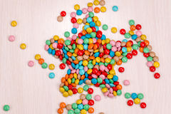 Candy scattered in the form of stars Royalty Free Stock Photos
