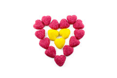 Candy in the shape of heart. Red and yellow stock photography