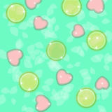 Candy in the shape of hearts and circles on a turquoise background with bokeh Stock Photography
