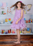 Candy shop. A beautiful girl holding lollipops in a candy shop Royalty Free Stock Image