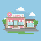 Candy shop building. Urban building with sign and storefront. City landscape with clouds and trees Stock Images