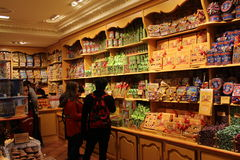 Candy shop. Customers in front of shelves full of colorful sweets in a french candy shop in spain: nougat, chocolate Royalty Free Stock Image