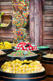 Candy shop. A stand with wide assortment of multicolored candy on a wooden background Royalty Free Stock Image