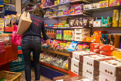 Candy shop. Woman buying candies and sweets in candy shop Royalty Free Stock Photo