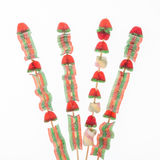 Candy skewer on white background. Some candies in a skewer on a white background Stock Images