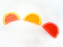 Candy Slices. Three candy fruit slices on a white background stock image