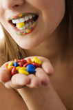 Candy smarties between teeth Royalty Free Stock Image