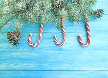 Candy, snow bump festive template design on a wooden background, Christmas tree. Candy, snow bump on a wooden background Christmas tree festive design template stock images
