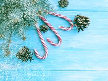 Candy, snow bump festive template decorative design on a wooden background, Christmas tree. Candy, snow bump on a wooden background Christmas tree design royalty free stock photos