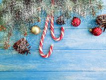 Candy, snow bump frame winter seasonal traditional on a wooden background, Christmas tree. Candy, snow bump on a wooden background Christmas tree greeting frame royalty free stock image