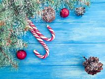Candy, snow bump frame template greeting design on a wooden background, Christmas tree. Candy, snow bump on a wooden background Christmas tree holiday decorative stock images